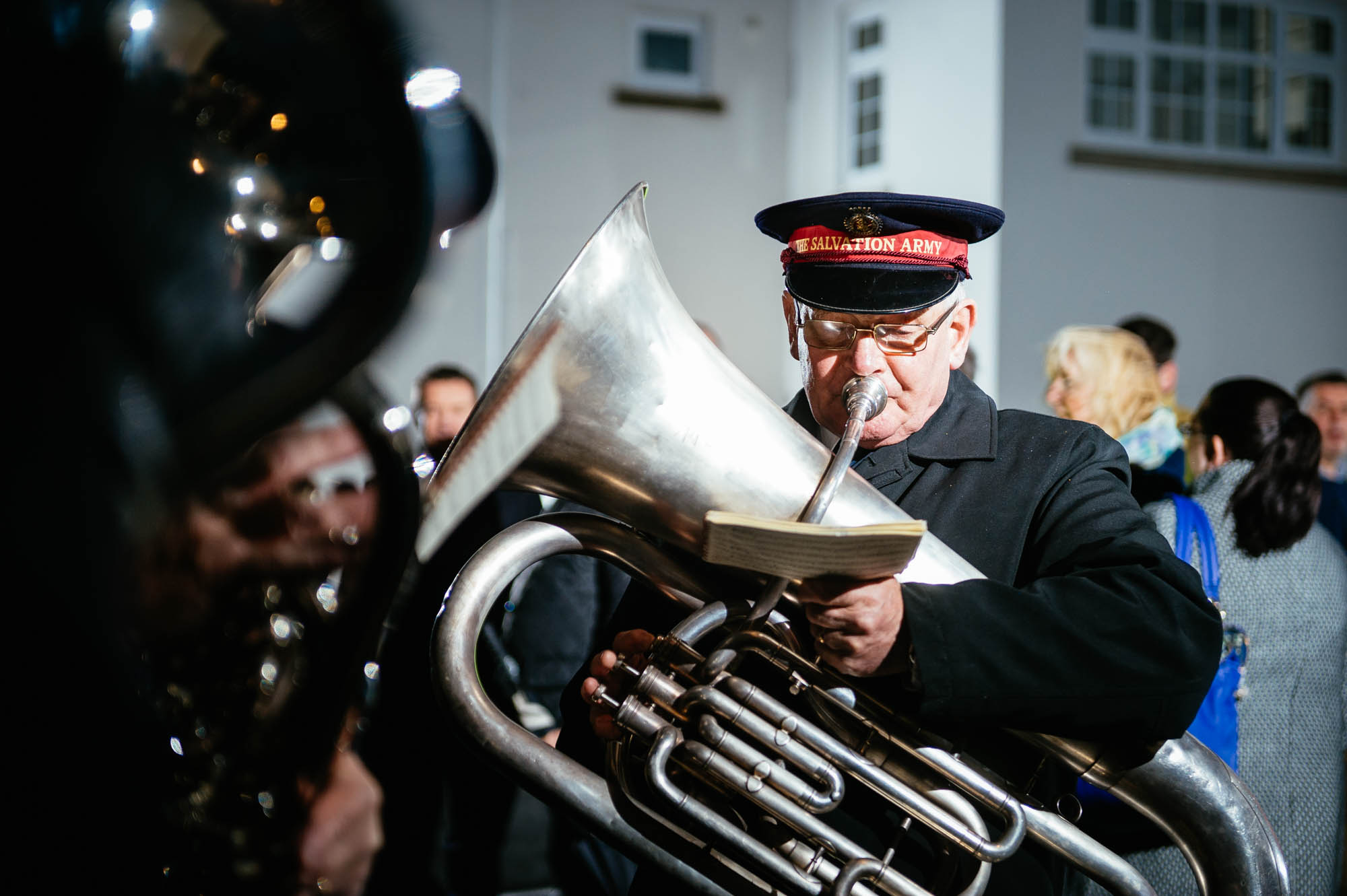 A photo of a salvation army band player in a cold wintery street in cardiff