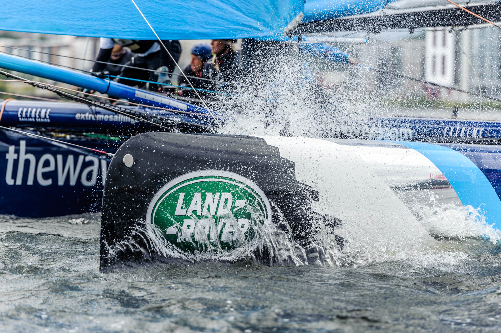 A photo of a super series catamaran kicking up spray in Cardiff