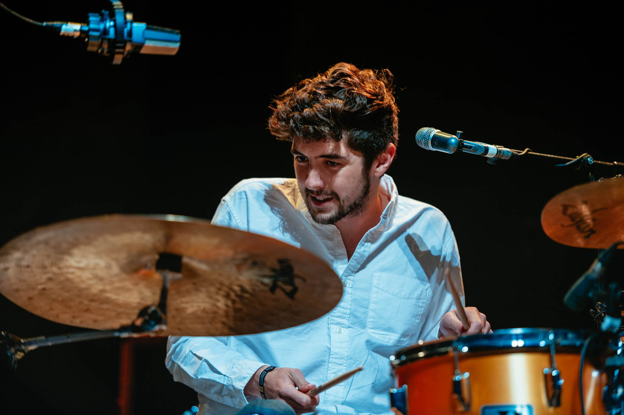 A photo of a drummer at the festival of voice