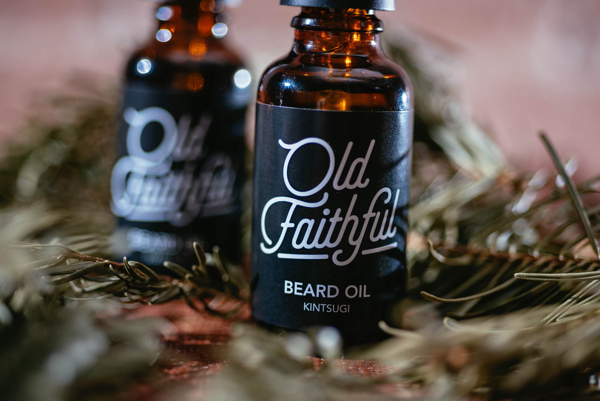 A photo of two bottles of beard oil
