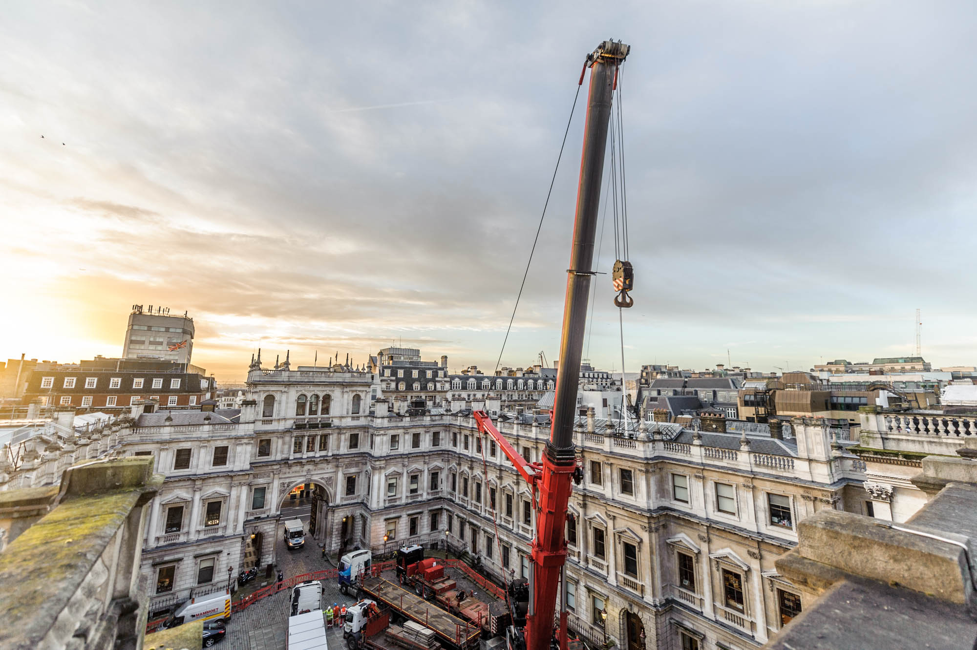 A photo of a crane rising above the london skyline