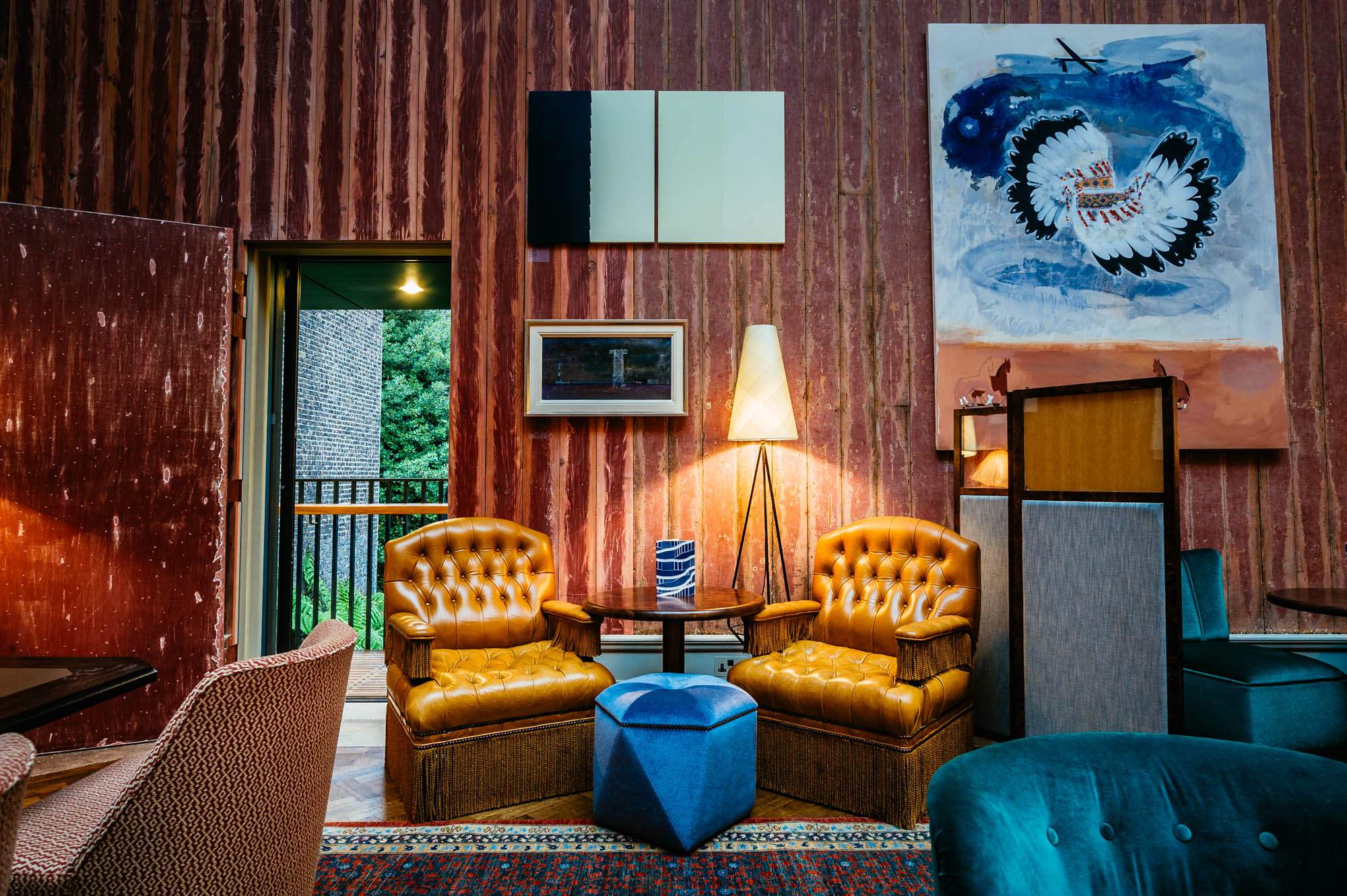 A photo of interior of a lounge space at a private members bar in london
