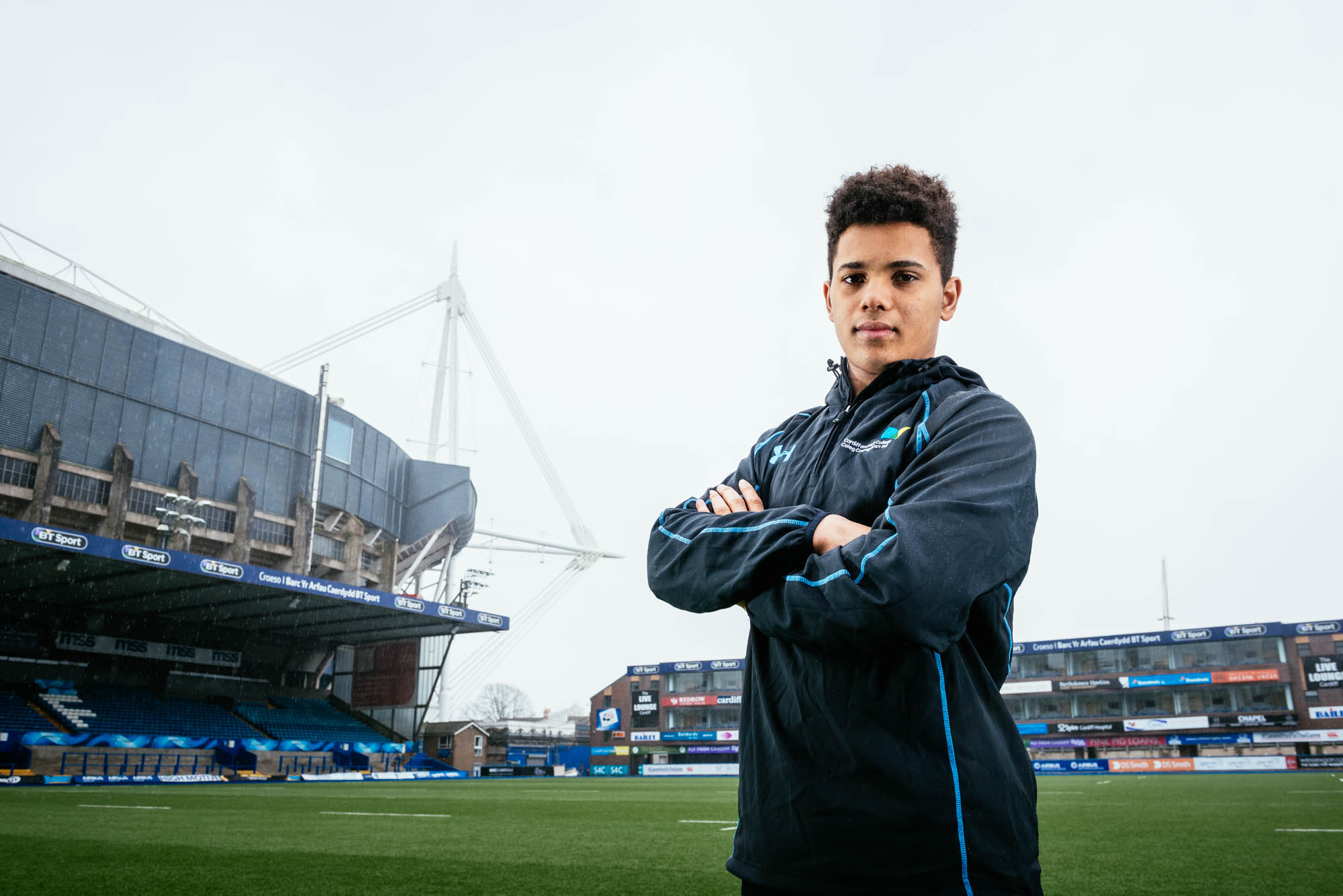 A photo of a rugby player at the arms park in cardiff with the millennium stadium behind