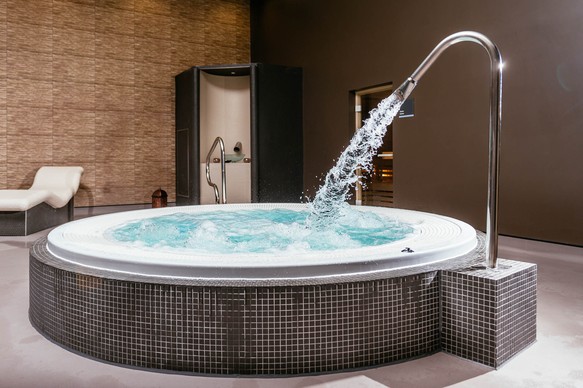 A photo of a spa venue with a hot tub and other relaxing treatments