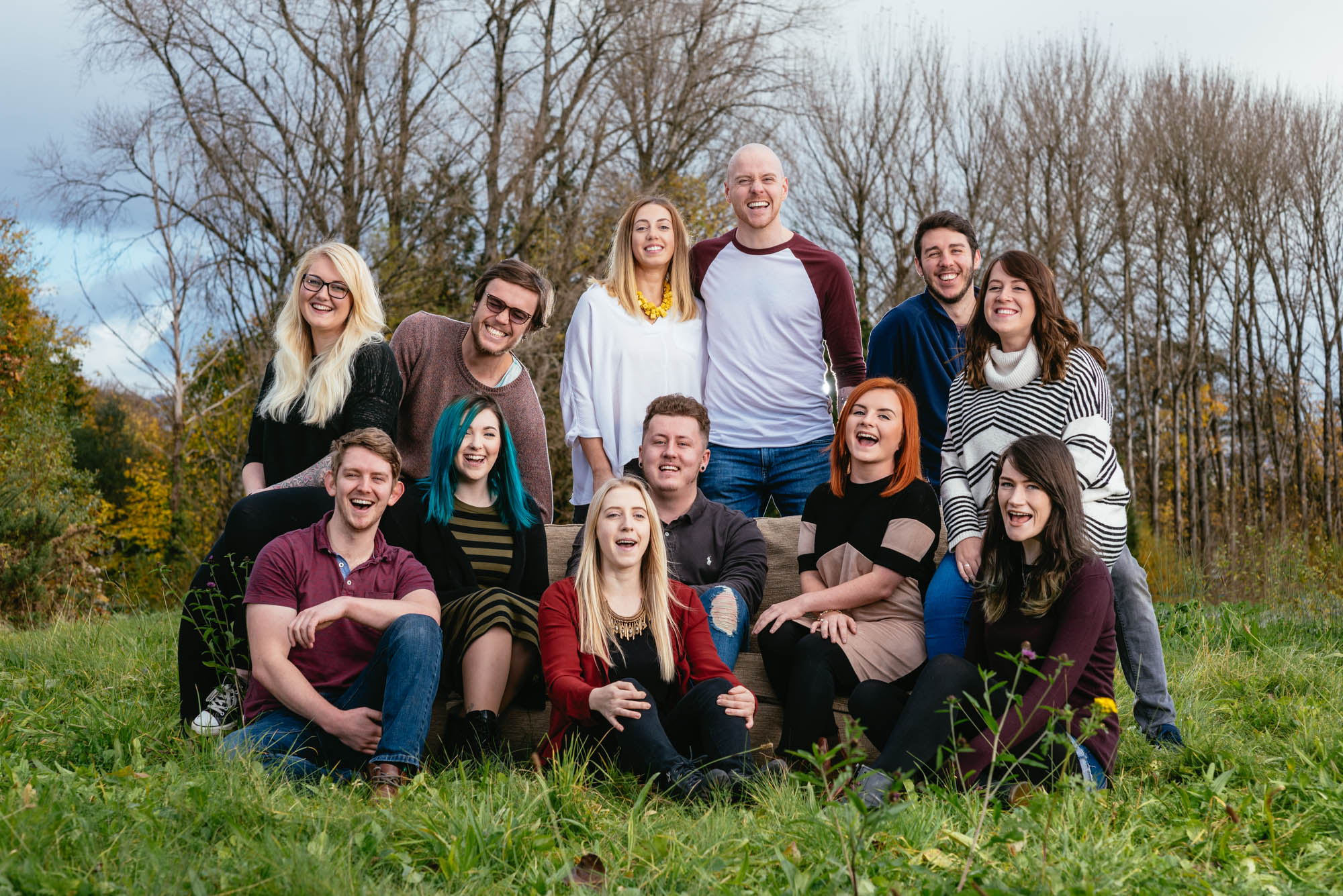 A team photo of the staff of dust and things laughing