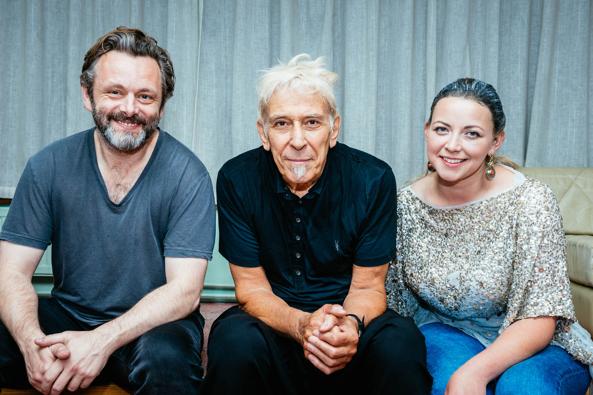 A photo of John Cale (centre) at Festival of Voice with Michael Sheen and Charlotte Church