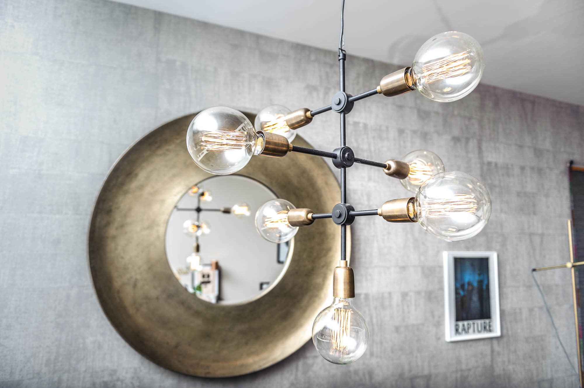 A photo of a bare bulb designer lamp in a modern home in cardiff