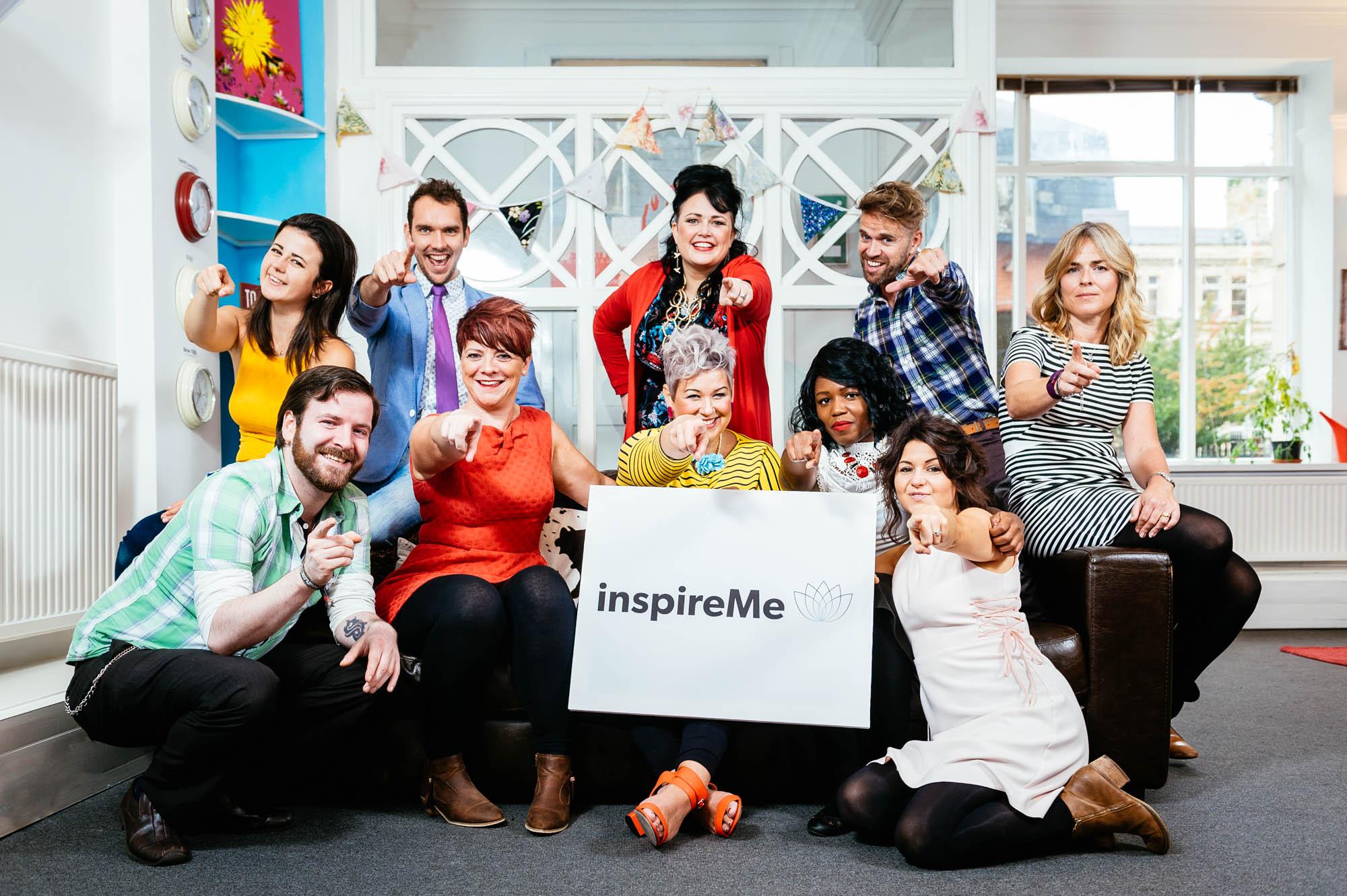 A team photo of a fun team in a colourful office